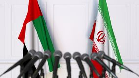 Flags of the UAE and Iran at international meeting or negotiations press conference. 3D animation stock footage
