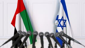 Flags of the UAE and Israel at international meeting or negotiations press conference. 3D animation stock footage