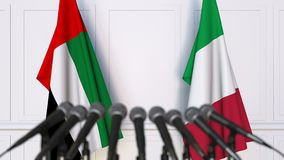 Flags of the UAE and Italy at international meeting or negotiations press conference. 3D animation stock video footage