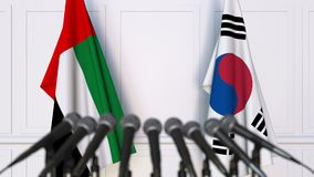 Flags of the UAE and Korea at international meeting or negotiations press conference. 3D animation stock footage