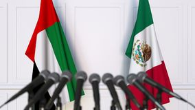 Flags of the UAE and Mexico at international meeting or negotiations press conference. 3D animation stock video