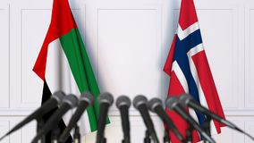 Flags of the UAE and Norway at international meeting or negotiations press conference. 3D animation stock video footage