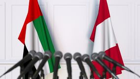 Flags of the UAE and Peru at international meeting or negotiations press conference. 3D animation stock video footage