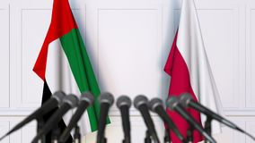 Flags of the UAE and Poland at international meeting or negotiations press conference. 3D animation stock video