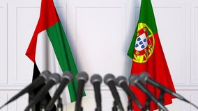 Flags of the UAE and Portugal at international meeting or negotiations press conference. 3D animation stock video footage