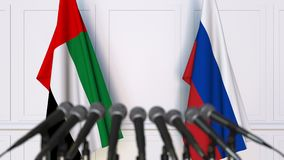 Flags of the UAE and Russia at international meeting or negotiations press conference. 3D animation stock video
