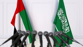 Flags of the UAE and Saudi Arabia at international meeting or negotiations press conference. 3D animation stock video footage