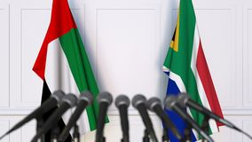 Flags of the UAE and South Africa at international meeting or negotiations press conference. 3D animation stock video
