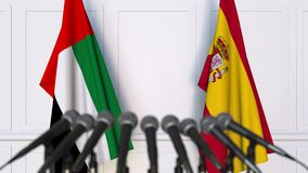 Flags of the UAE and Spain at international meeting or negotiations press conference. 3D animation stock video