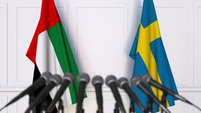 Flags of the UAE and Sweden at international meeting or negotiations press conference. 3D animation stock video
