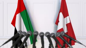 Flags of the UAE and Switzerland at international meeting or negotiations press conference. 3D animation stock video footage