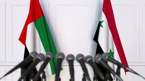 Flags of the UAE and Syria at international meeting or negotiations press conference. 3D animation stock video