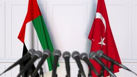 Flags of the UAE and Turkey at international meeting or negotiations press conference. 3D animation stock video footage