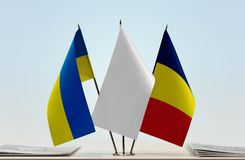 Flags of Ukraine and Chad. Desktop flags of Ukraine and Chad with white flag between stock photos