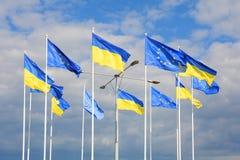 Flags of Ukraine and European Union EU against the blue sky. Flags of Ukraine and European Union EU against the blue sky Royalty Free Stock Photo