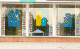 Flags of Ukraine, European Union and national patterns of embroi. Flags of Ukraine, the European Union and national patterns of embroidery in the shop window Royalty Free Stock Photo