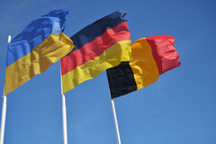 Flags of Ukraine, German, and Belgium Royalty Free Stock Images