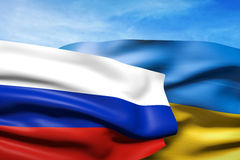 Flags of Ukraine and Russia. Over blue sky Stock Photography