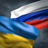 Flags of Ukraine and Russia. Over dark sky Royalty Free Stock Images