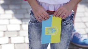 Flags of Ukraine souvenir. Souvenir flag of Ukraine in hand kind stock footage