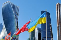 Flags of Ukraine and Turkey against of Moscow City skyscrapers royalty free stock image