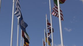 Flags of the UN, US and UK. The flags of the United Nations, United States and the United Kingdom flying on flagpoles stock video