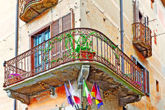 Flags under Balcony Royalty Free Stock Image