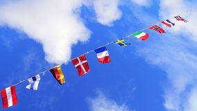 Flags, united colors of the world. Flags waving in the sky, a lot of nations represented Stock Photo