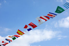 Flags, United Colors of the World. Flags waving in the sky, a lot of nations represented Stock Image