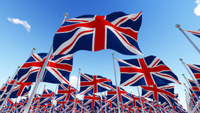 Flags of United Kingdom against blue sky. Stock Photography
