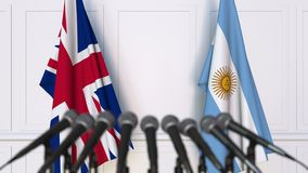 Flags of the United Kingdom and Argentina at international meeting or negotiations press conference. 3D animation stock video
