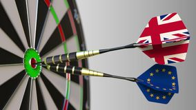 Flags of the United Kingdom and the European Union on darts hitting bullseye of the target. International cooperation or. Competition animation stock footage