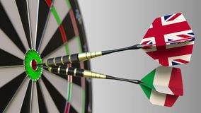 Flags of the United Kingdom and Italy on darts hitting bullseye of the target. International cooperation or competition. Animation stock video