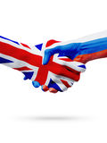 Flags United Kingdom, Russia countries, partnership friendship handshake concept. Royalty Free Stock Photography