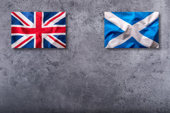 Flags of the united kingdom and scotland on concrete background Stock Photography