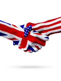 Flags of United Kingdom and United States countries, overprinted handshake. Royalty Free Stock Photography