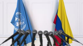 Flags of the United Nations and Colombia at international meeting or negotiations press conference. 3D animation stock video footage