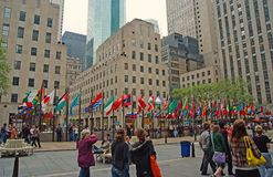 Flags of united nations member countries in new york, usa. New York, USA - November 13, 2008: flagpoles with flags of united nations member countries and people royalty free stock image