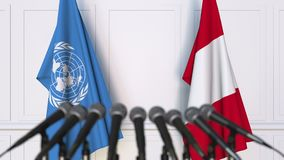Flags of the United Nations and Peru at international meeting or negotiations press conference. 3D animation stock video