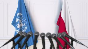 Flags of the United Nations and Poland at international meeting or negotiations press conference. 3D animation stock video footage