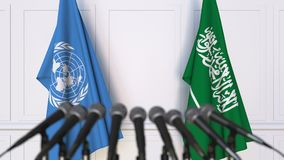 Flags of the United Nations and Saudi Arabia at international meeting or negotiations press conference. 3D animation stock video