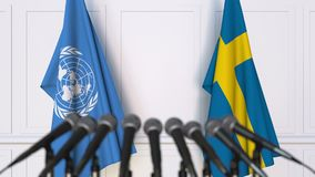 Flags of the United Nations and Sweden at international meeting or negotiations press conference. 3D animation stock video footage