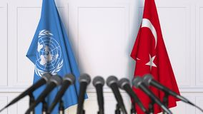 Flags of the United Nations and Turkey at international meeting or negotiations press conference. 3D animation stock video footage