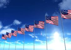 Flags of the United States of America under blue sky. 3D rendering Royalty Free Stock Photo