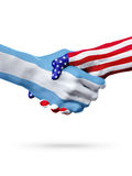 Flags of United States and Argentina countries, overprinted handshake. Royalty Free Stock Image