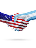 Flags United States and Argentina countries, partnership handshake. Stock Photo