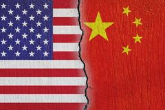 Flags United States and China painted on cracked  wall royalty free stock images