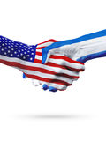 Flags United States and El Salvador countries, partnership handshake. Royalty Free Stock Photos