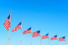 Flags of the United States. Waving over blue sky in Washington DC royalty free stock image