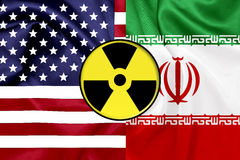 Flags of United States and Iran with Nuclear icon Royalty Free Stock Images